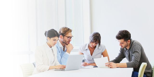 SDL Trados GroupShare - Four people in a work meeting